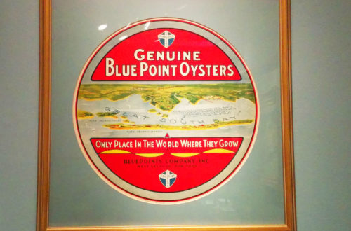 A vintage Blue Point Oyster sign for oysters grown in the Great South Bay