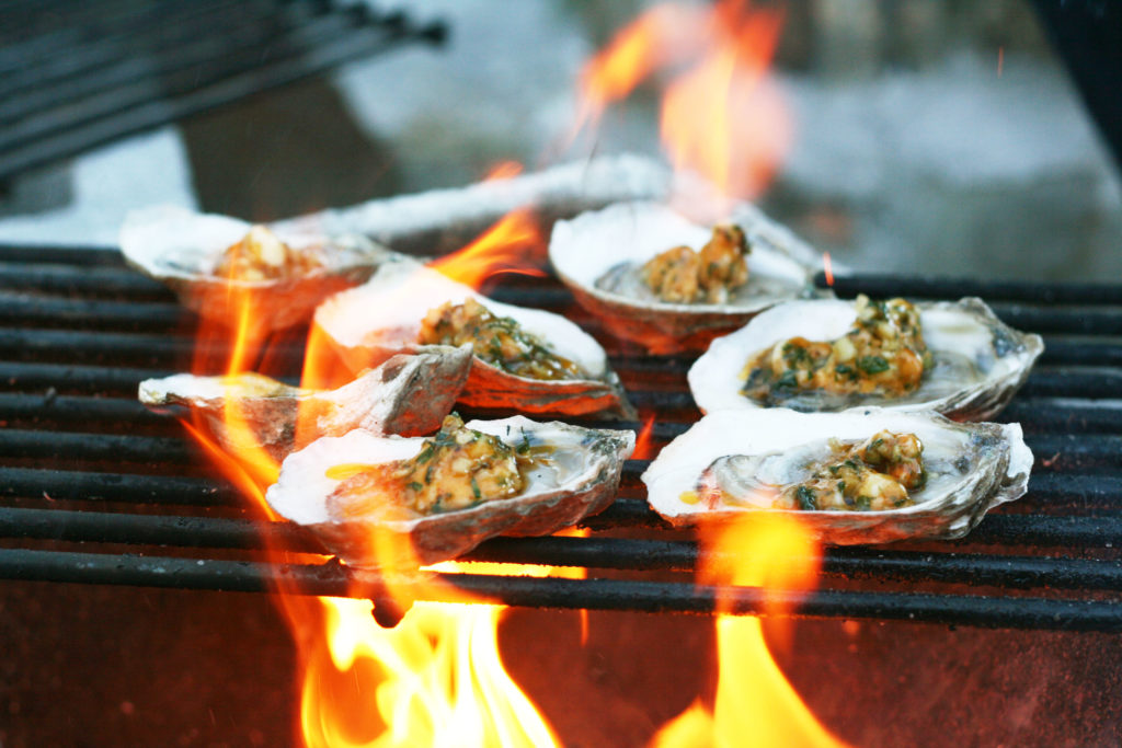 Oysters topped with garlic butter and grilled
